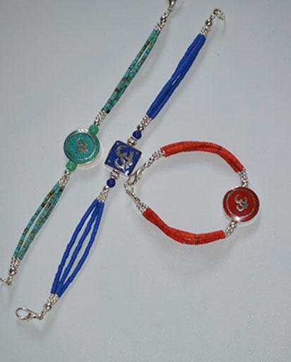 White Metal OM Bracelets